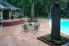 Stephens and Smith Construction created an eye catching decorative concrete pool deck and patio at this private residence using Bomanite Slate Texture and Bomanite Soldier Course Used Brick patterns to create a space that is full of charm with a welcoming feel.